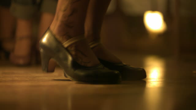 Slow motion woman's dancing, tattooed feet, Spain (Individual frames may also be used as a still image. Each frame in its raw state is about 6MB or about 12MB as a 16 bit TIFF)
