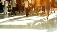 HD Slow Motion:Crowd people walking on sunset in the city streets