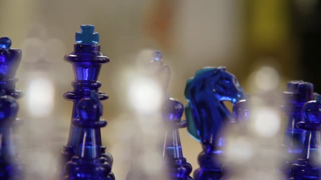 Slow Pan of Orante Glass Chess Pieces on Board