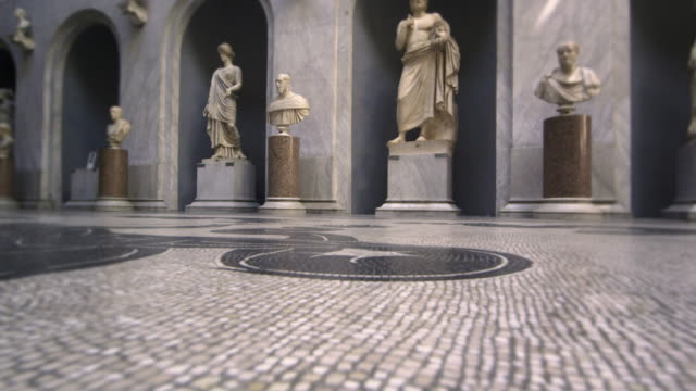 Slow pan of statues, busts, and floor of New Wing