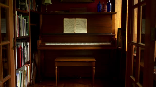 Slow push in on piano and sheet music.