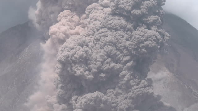 Slow zoom on a large pyroclastic flow as it tears down the flanks of Mt Sinabung in Indonesia during a powerful eruption
