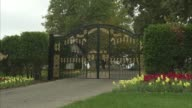 A slow zoom out shot of the black and gold entry gates to the Neverland Ranch property in Los Olivos California A wide shot of the Neverland Ranch...