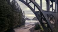 Slowly flying under Cape Creek Bridge towards the beach