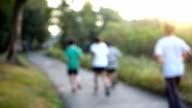 Slow-Mo: Group Running At Sunset