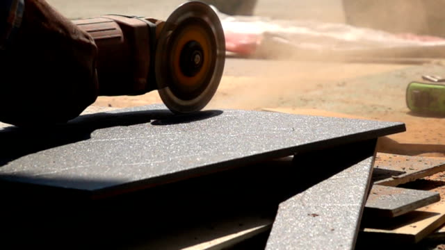 Slow-motion, Electric saw cutting tiles floor