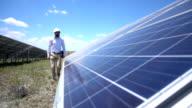 Slowmotion Technician At Solar Power Station