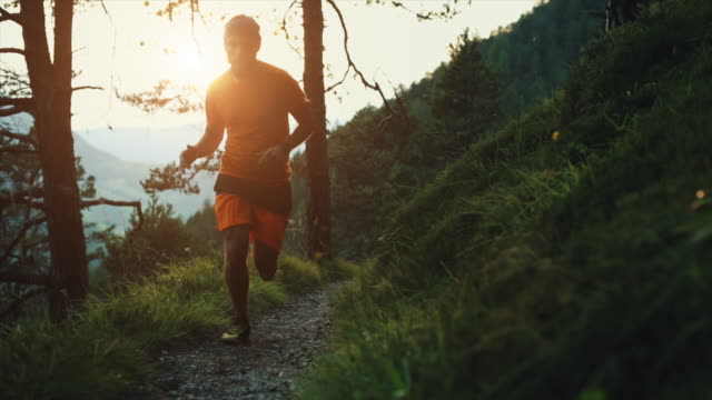 Slow-motion trail running in the forest: off-road run