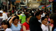 Slum district in Manila / Marketplace / Various of rice harvested in paddy field More of busy marketplace / Traffic and bikes along crowded street /...