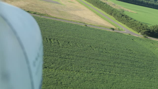 Small Airplane Landing on a Rural Airport Runway