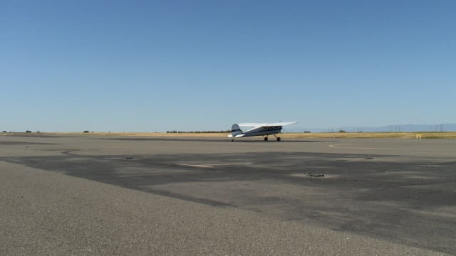 WS, Small airplane riding and stopping on tarmac, Red Bluff, California, USA