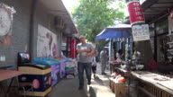 Small art shops and comic statues are common sights in alleys and hutongs 798 art zone is a famous travel destination and cultural landmark in...