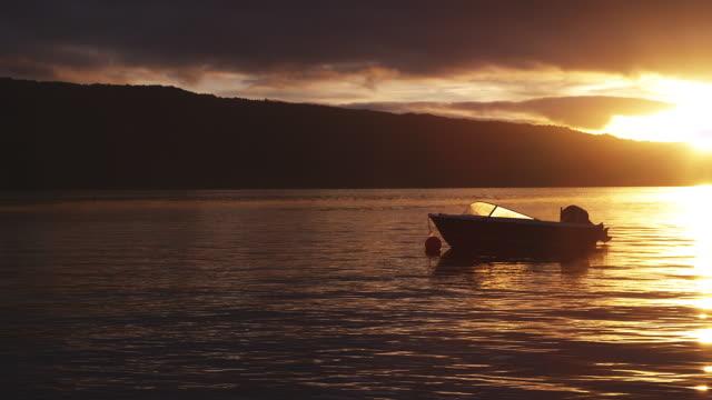 A small boat moors on Lake Tarawera, Rotorua, New Zealand.