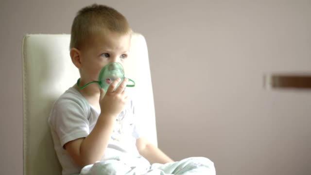 small boy inhaling