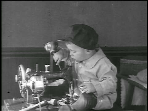 B/W 1926/29 small boy playing with oil can + sewing machine / newsreel