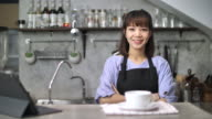 Small business owner in cake and coffee shop, Slow motion