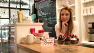 Small business owner in cake and coffee shop