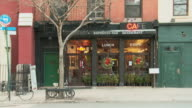 TS Small café with christmas wreaths / New York, New York, USA