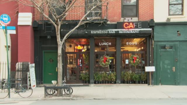 TS Small café with christmas wreaths / New York, New York, USA