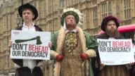 A small group of protesters dressed as Tudors gather in front of parliament to protest the government's proposal to use special executive authority...