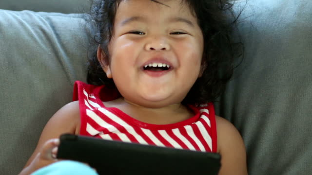 Small happy child with tablet