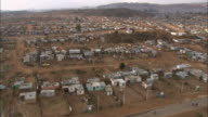 Small houses populate a neighborhood in Soweto, South Africa.
