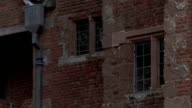 Small rectangular windows and red brick characterize Harvington Hall in Kidderminster, England. Available in HD.