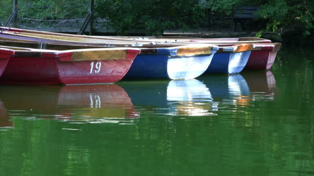 Small rowing boats floating on lake, copy space, HD