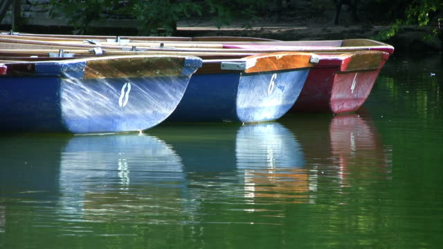 Small rowing boats floating on lake, peaceful, HD