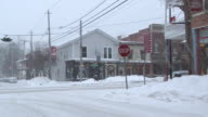MS Small ski town street in blizzard  / Ellicottville, New York, Canada