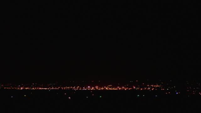 WS Small town in Mojave Desert illuminated at night / California, USA