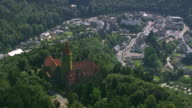 MS AERIAL Small village Esch Sur Sure and Reservoir on river set in tree covered mountain / Luxembourg