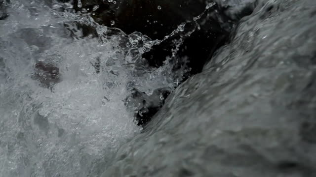 Small waterfall in woodland in autumn - SLOW MOTION