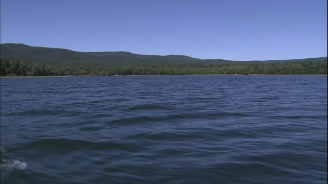 Small waves ripple on the surface of Lake Akan in Hokkaido, Japan.