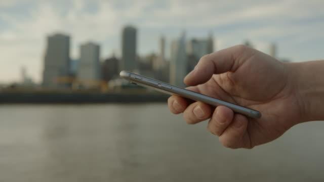 Smart phone Downtown Manhattan New York City Summer