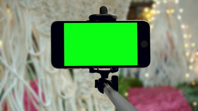 Smartphone groen scherm chromakey feestdagen Christmas New York City mobiele