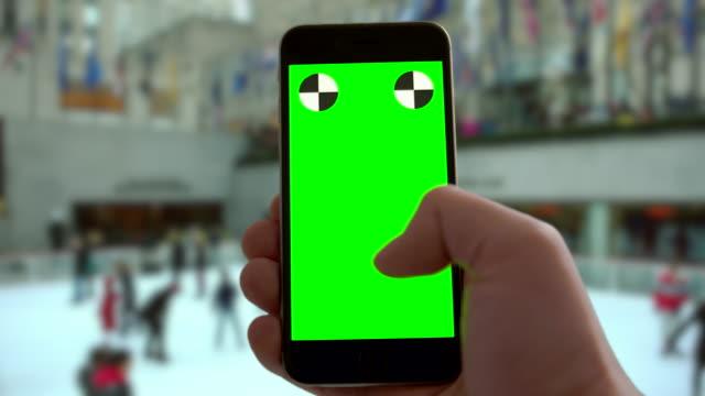 Smartphone groen scherm chromakey vakantie New York City Christmas schaatsen