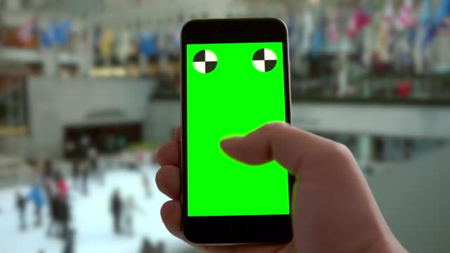 Smartphone groen scherm chromakey schaatsen New York City kerstvakantie