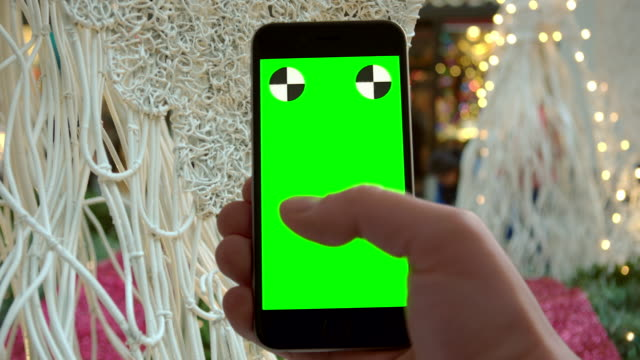 Smartphone groen scherm chromakey New York City mobiele Kerstverlichting