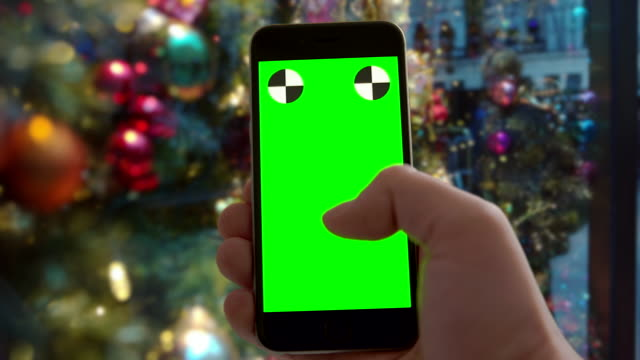 Smartphone green screen chromakey New York City Christmas ornament mobile
