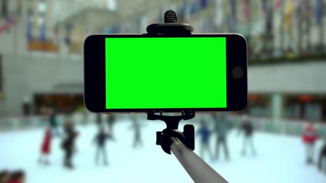 Smartphone groen scherm chromakey New York schaatsen Kerst vakantie mobiel