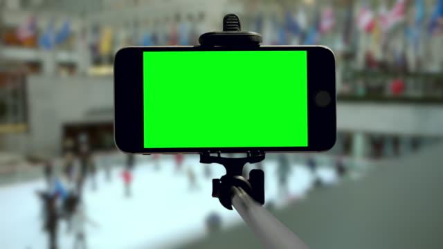 Smartphone schaatsen New York City Kerst vakantie mobiel groen scherm