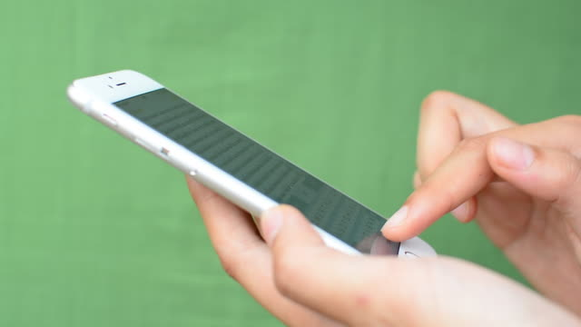 Smartphone touchscreen on green screen