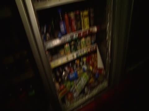Smashed drinks cabinet inside shop damaged during riots United Kingdom August 2011