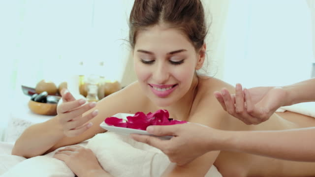 Smelling a rose,Beautiful woman for relaxing in spa.