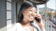Smiley African Business Women on mobile phone
