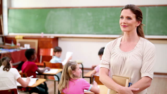 Smiling teacher standing upright
