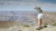 Smiling Woman at Grand Canyon Rim