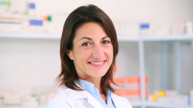 Smiling woman pharmacist