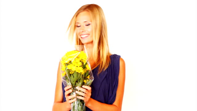 Smiling young lady holding a bouquet